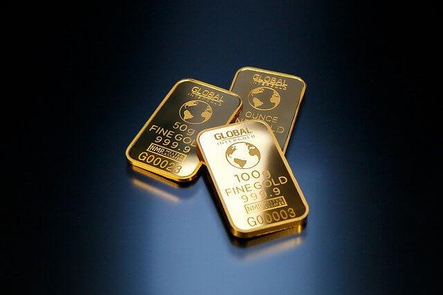金のインゴットが3つ重なってる