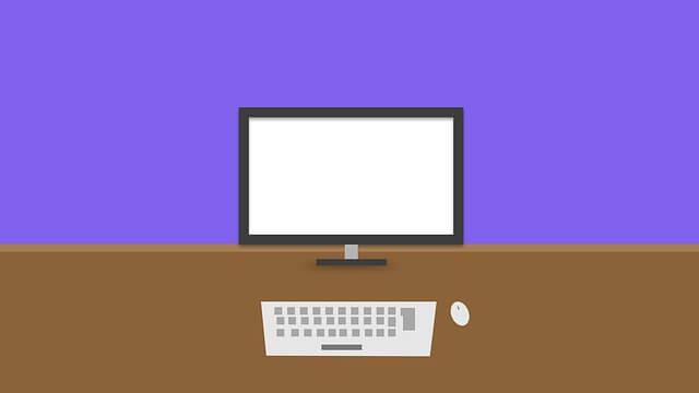 紫の背景にPCが1台