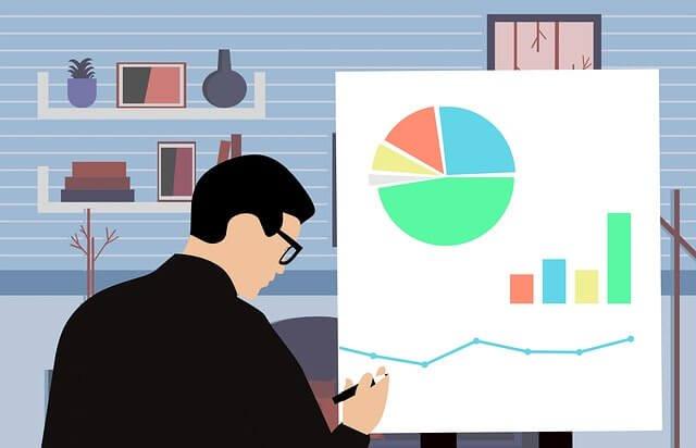 グラフを書いている男性